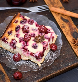 Cheesecake with cherries on a glass plate