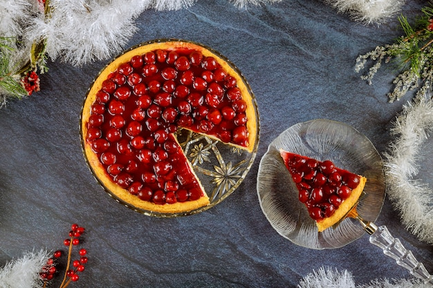 Cheesecake with cherry topping and christmas decoration