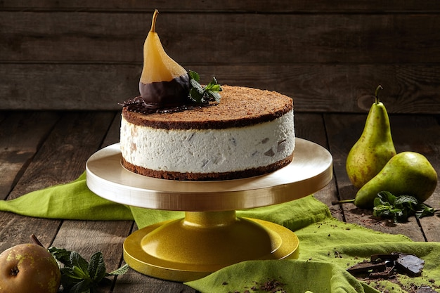 Cheesecake with chocolate shortbread and poached pear
