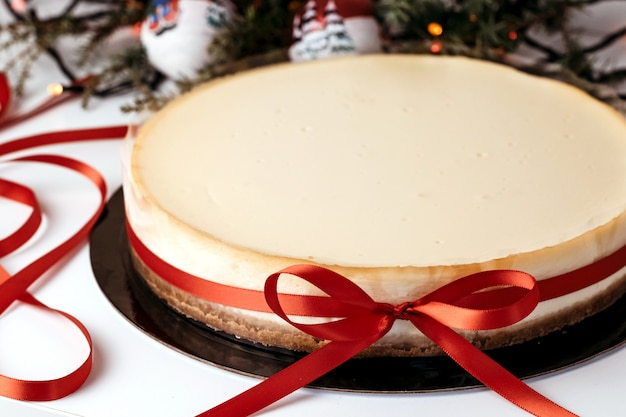 Cheesecake with red ribbon.