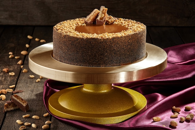 Cheesecake with salted caramel peanuts and chocolate bar