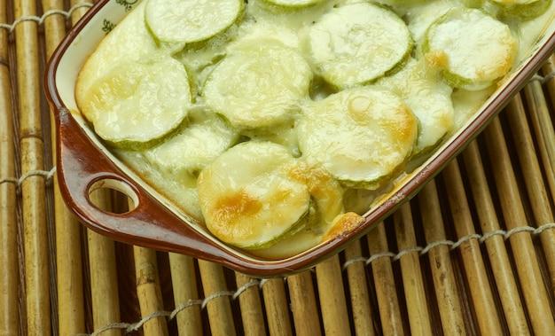 Cheesy squash casserole , ts richness from parmesan, cheddar ,  sour cream, summer squas/