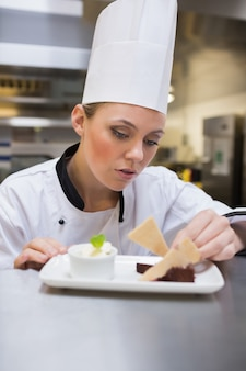 Chef carefully garnishing desert