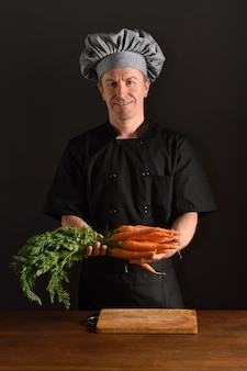 Chef chopping a carrot