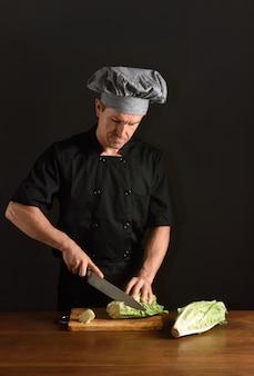 Chef chopping a lettuce