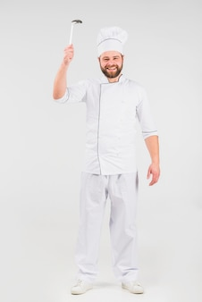 Chef cook with ladle smiling