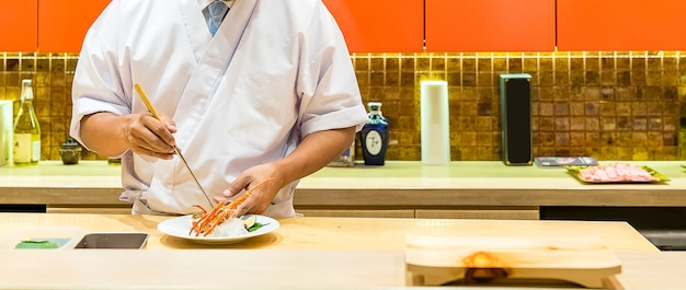 Chef cooking lobster sashimi