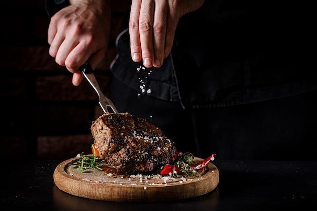 The chef cooking tasty pork steak