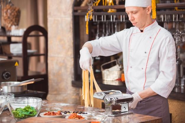 Chef cooks spaghetti in a premium restaurant.