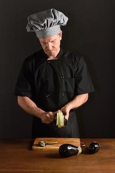 Chef cutting  eggplant,