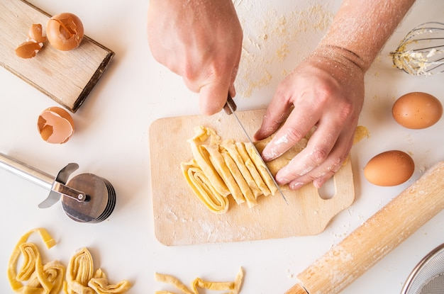 Chef cutting pasta dough
