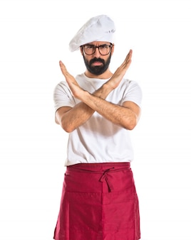 Chef doing no gesture over white background