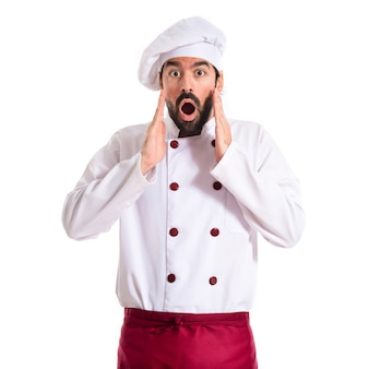 Chef doing surprise gesture over white background