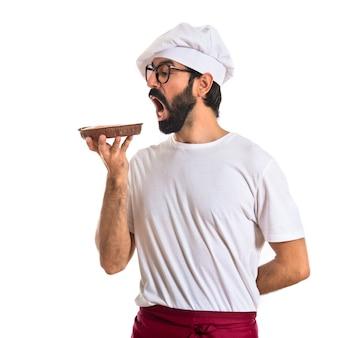 Chef mangiare una torta