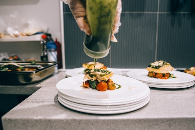 Chef finishing food in his restaurant kitchen