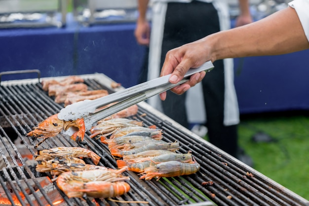 Chef grilled river shrimp or thai shrimp on barbeque stove.