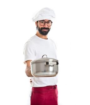 Шеф-повар держит горшок