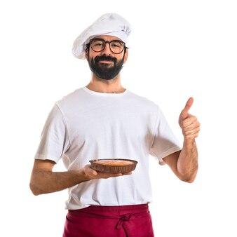 Torta di holding del cuoco