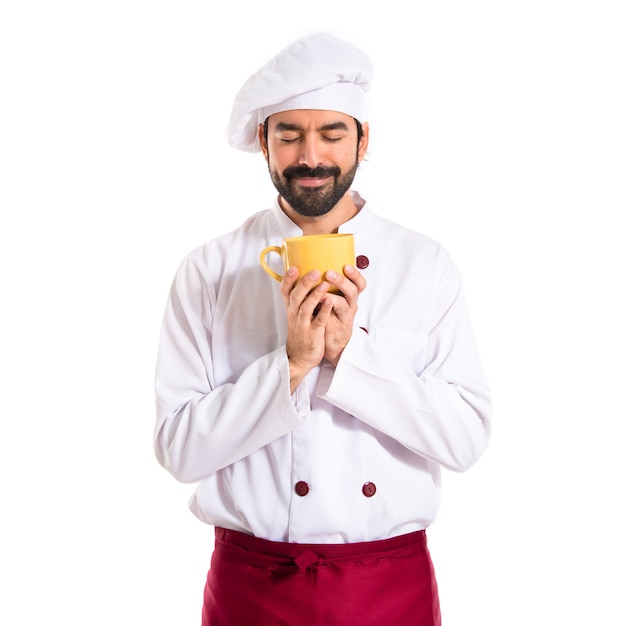 Chef holding a cup of coffee over white background