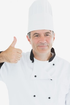 Chef in uniform showing thumbs up sign
