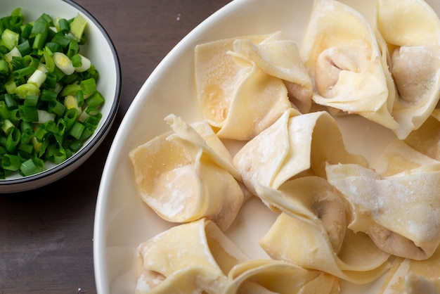 The chef is making meat wonton