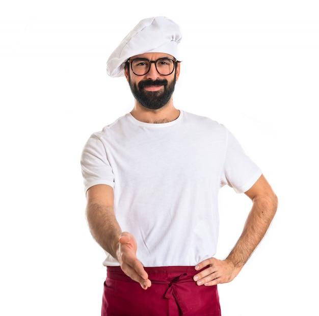 흰색 배경 위에 거래를 만드는 요리사