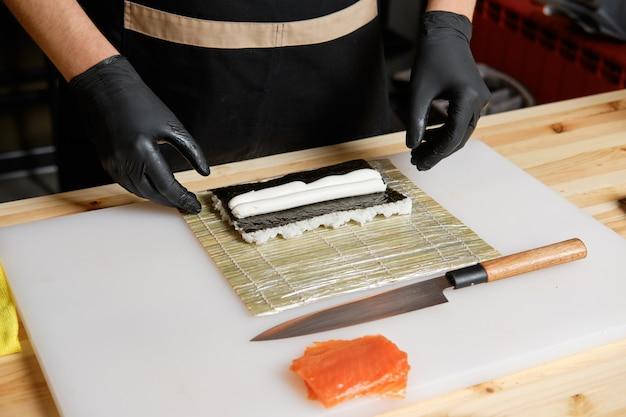 Chef making salmon rolls