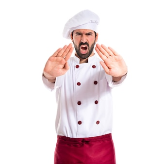 Chef making stop sign over white background