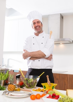 Chef male portrait on white countertop at kitchen