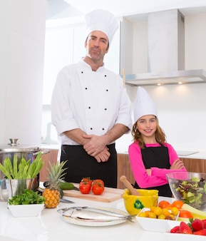 Chef master and junior pupil kid girl at cooking school