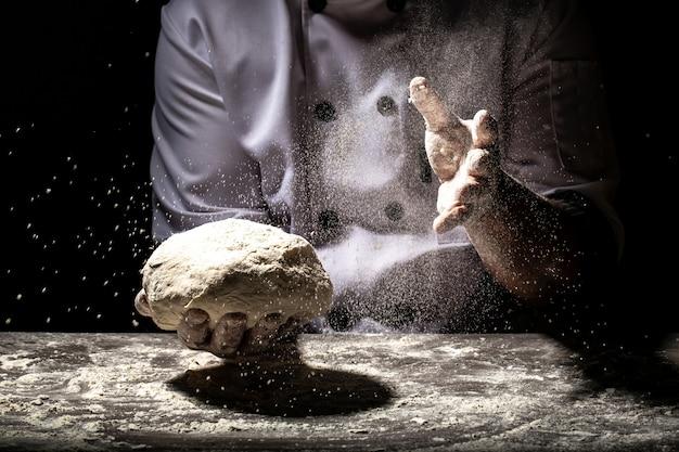 Chef prepares the dough with flour to make the bio italian pasta