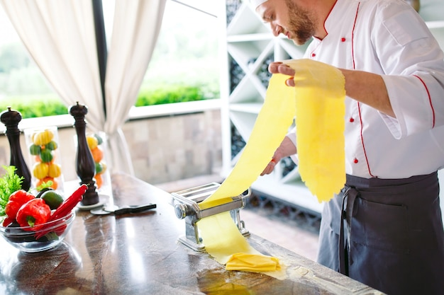 The chef prepares the paste for the visitors.