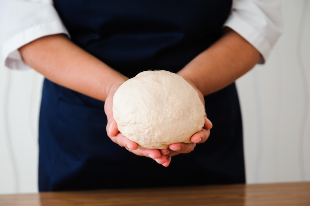 Chef preparing dough. cooking process, work with flour