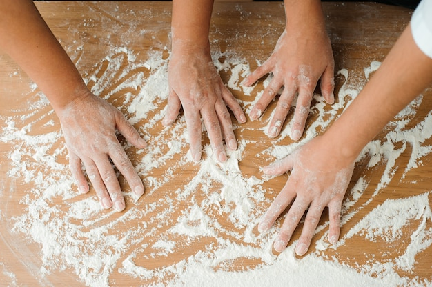 Chef preparing dough. cooking process, work with flour.