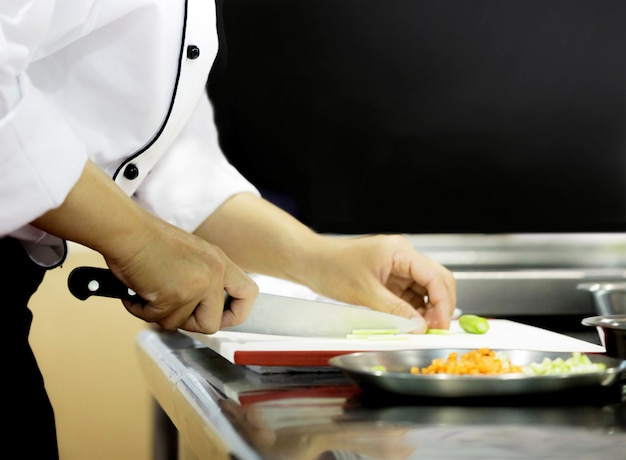 Chef preparing food, meal, in the kitchen, chef cooking, chef decorating dish