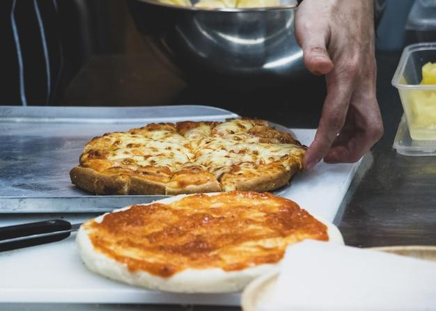 Chef preparing pizza , the process of making pizza