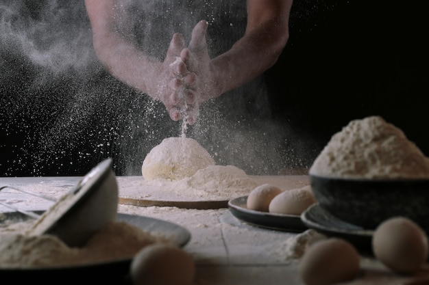 Chef in the process of making a pizza dough