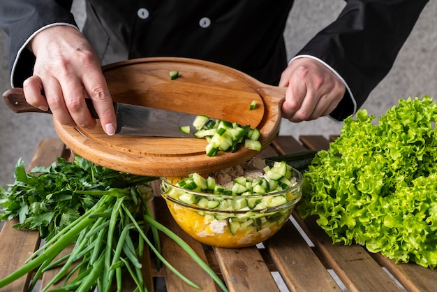 Chef putting ingredients in bowl