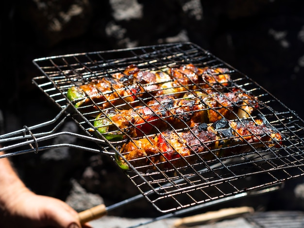 Chef roasting vegetables on grill