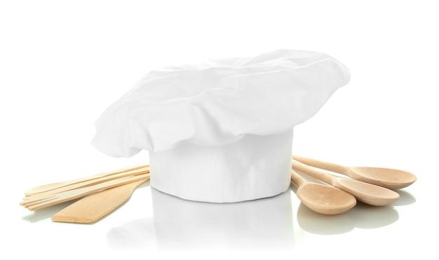 Шляпа шеф-повара с ложками, изолированные на белом фоне