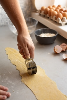 Chef shaping pasta dough