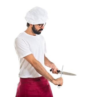 シェフ、ナイフを磨く