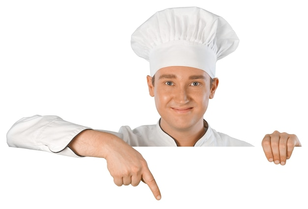 白い背景で隔離の制服の看板看板を示すシェフ