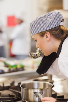Chef smelling her soup