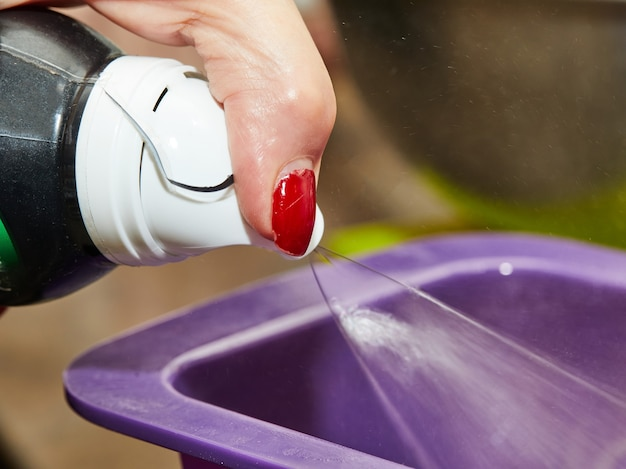 Chef sprinkles butter to grease the silicone baking dish