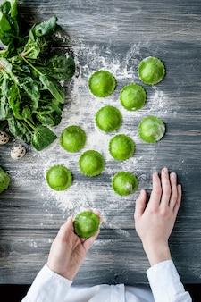 Chef step by step, preparing a green ravioli