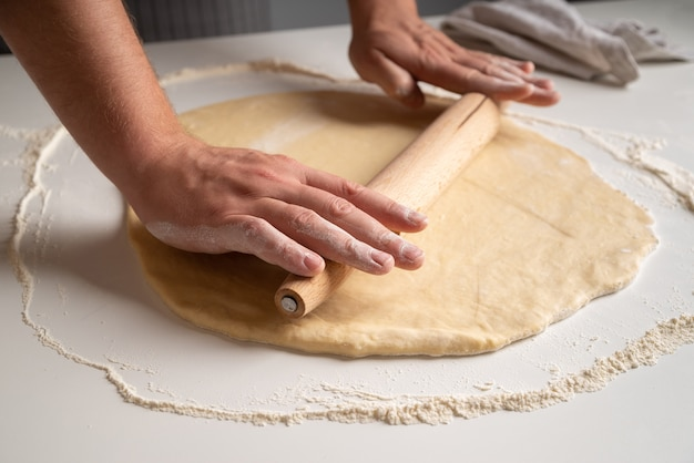 Chef stratching dough in flour