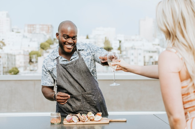 Chef toasting at a rooftop party