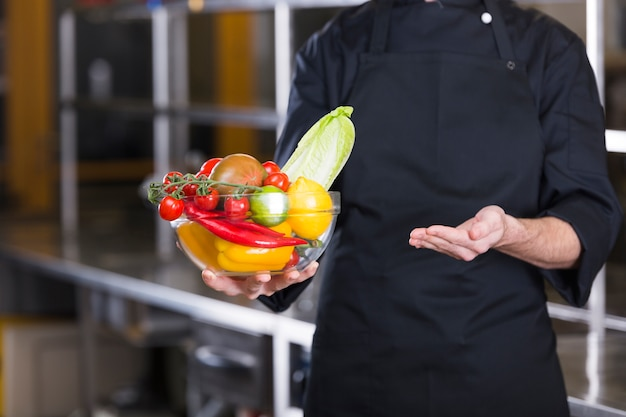 Chef with fruits and vegetables