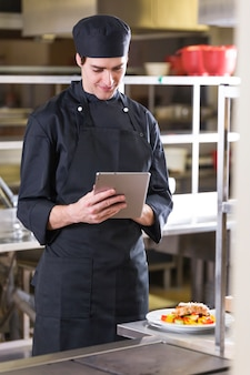 Chef with a tablet